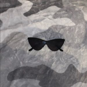 A black pair of sun glasses